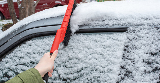 Clearing snow from windshield